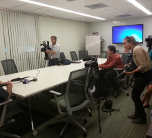 Media reporters interview Detective Ed Weber and Sr. Vice President Tony Callisto in the DPS conference room in Sims Hall.