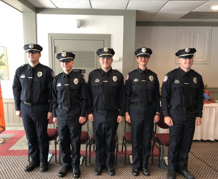 Five new public safety officers standing at attention